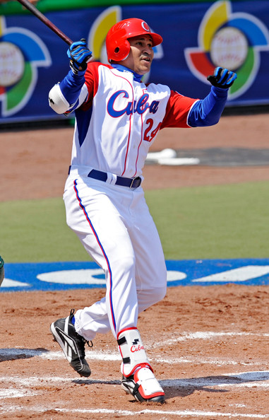 Frederich Cepeda #24 of Cuba looks at his one run home run clear the right field fence against South Africa during the 2009 World Baseball Classic Pool B match on March 8, 2009 at the Estadio Foro Sol in Mexico City, Mexico. Cuba won, 8-1. (Photo by Kevork Djansezian/Getty Images)