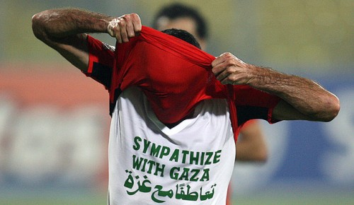 "Egyptian player Mohamed Aboutrika wears a T-shirt reading ""Sympathize with Gaza"" in English and Arabic as he celebrates his goal 1-0 against Sudan in Kumasi 26 January 2008 during the African Cup of Nations football championship. Aboutrika flashed the shirt after he scored his first goal in view of cameras and millions of spectators throughout the world which prompted the referee to slap him with yellow warning card for violating the FIFA rules which prohibit religious and political slogans during the games, although the phrase is more humanitarian than political. Israel pressured Google to remove all the images of him showing his T-shirt. 