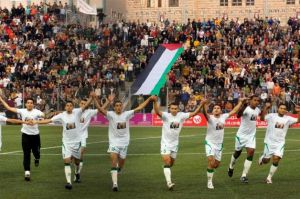 In this Oct. 26, 2008, file photo, players of the Palestinian soccer team are seen on the field prior a match with Jordan at a stadium in the West Bank town of Aram, near Jerusalem.
