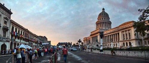 Cuba.Marabana 2012.Runners pass Havana's Capitolio building