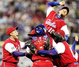 Cuban team celebrates after defeating the powerful Puerto Rican team