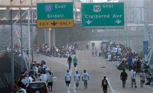 Survivors of Hurricane Katrina trapped on Interstate 10 near the Superdome on Aug. 31, 2005,. When they tried to cross over the Mississippi River bridges, New Orleans police fired on them. (Photo: Irwin Thompson/Dallas Morning News)