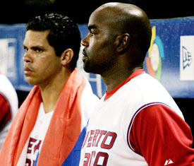 Carlos Delgado and Ricky Ledes watch the Cubans come back