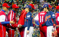 Cuban and Japanese players exchange traditional handshakes following the final