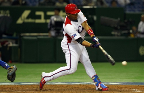 Outfielder Yasmany Tomas #27 of Cuba hits a three run home run in the top half of the sixth inning during the World Baseball Classic Second Round Pool 1 game between Chinese Taipei and Cuba at Tokyo Dome on March 9, 2013 in Tokyo, Japan | Koji Watanabe/Getty Images AsiaPac