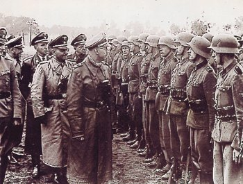 Heinrich Himmler inspecting troops of the 14th Waffen SS Division (Galicia), staffed by OUN/ (B). Both Hitler and Himmler had headquarters installations built in the Zhytomyr area of Ukraine. Between summer 1941 and fall 1943, the Germans and their collaborators murdered 180,000 Jews in the Zhytomyr region, with the majority of women, children and infirm killed in August and September 1941.