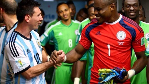 Photo of the day: Vincent Enyeama, Nigeria's No 1 goalie, was all smiles as he pumped fists with Argentine talisman, Lionel Messi, in the tunnel before the world cup game  between Nigeria and Argentina; with the Albiceleste running out 3-2 winners.