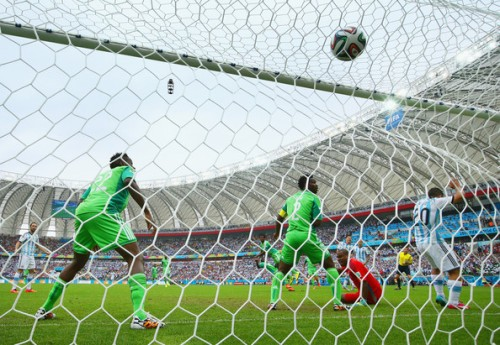 Lionel Messi of Argentina scores his team's first goal past Vincent Enyeama of Nigeria during the 2014 FIFA World Cup Brazil Group F match between Nigeria and Argentina at Estadio Beira-Rio on June 25, 2014 in Porto Alegre, Brazil. (June 24, 2014 - Source: Ian Walton/REMOTE/Getty Images South America)