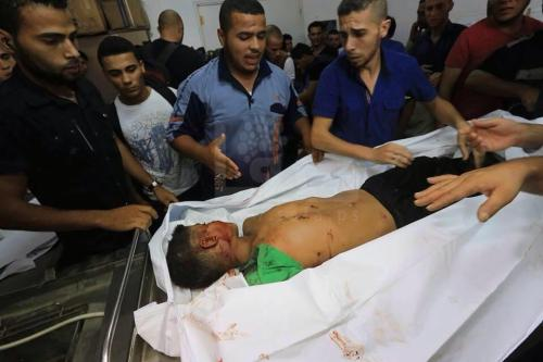 CiLLi via Twitter Report. 4 Kids Killed in #Gaza while playing football near beach by #Israel Missiles today. Ameen http://pic.twitter.com/aAxDLGo9cZ