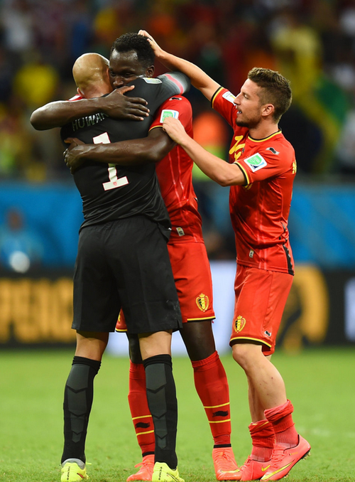 Belgium's Romelu Lukaku (facing camera) embraces goalkeeper Tim Howard at the end of their 2014 World Cup round of 16 game | Reuters
