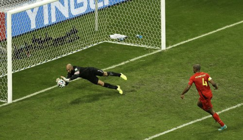 US goalkeeper Tim Howard makes a save as Belgium defender Vincent Kompany (R) looks on | AP Photo