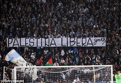 Hungarians display a banner and Palestine flags during a match against Tottenham Spurs at the Stadio Olympiico, Nov. 22, 2012