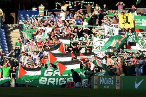 Celtic fans wave Palistinian flags during the game against KR Reykjavik at Murryfield in July | Scotland Now