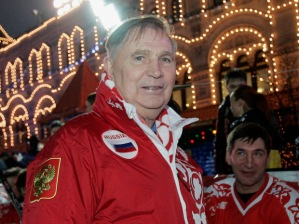 """In this Dec. 9, 2006 file photo, Legendary Soviet ice hockey coach Viktor Tikhonov, centre, stands at the """"Team USSR"""" bench prior to the charity ice hockey match, at the Moscow's Red Square 