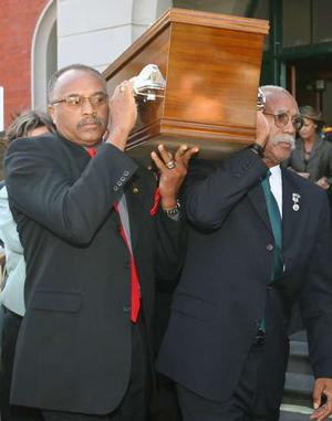 Tommie Smith (left) and John Carlos carry Peter Norman's coffin | Wayne Taylor.
