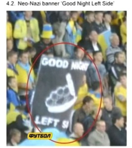 "A banner of ""Good Night Left Side"" with brass knuckles and a razor blade on display in Lviv Arena stadium on Sept. 6, 2013"
