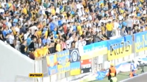 Ukrainian soccer fans in Lviv doing a Nazi salute against their own team member. (photo credit: YouTube screenshot)
