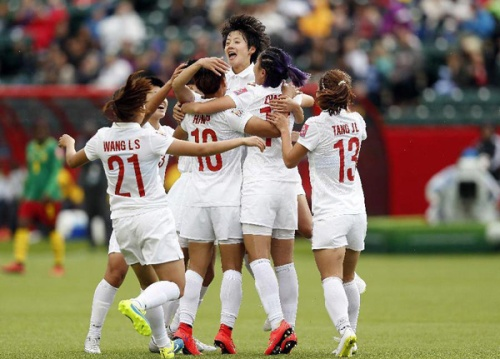 China's players celebrate a goal during a round of 16 match between China and Cameroon at the Commonwealth Stadium in Edmonton, Canada, on June 20, 2015. [Photo/Xinhua]