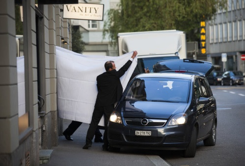 The raids were strategically timed and the US media strategically placed; FIFA officials escorted out behind sheets at the Baur-a--Lac Hotel in Zurich | Pascal Mora, New York Times
