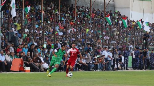Gaza's Shujaiyeh United soccer club plays Hebron's Al-Ahly soccer club at Alyarmouk stadium in Gaza City, August 6, 2015 | AP