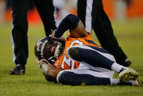 David Bruton of the Denver Broncos after a play that would force him out of the game with a concussion | Doug Pensinger/Getty Images