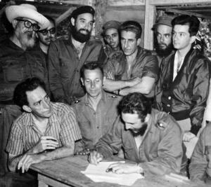 Fidel Castro signs the 1959 Agrarian Reform Law.