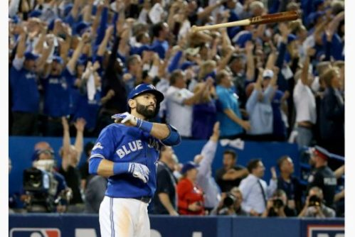 Jose Bautista of the Toronto Blue Jays throws his bat up in the air after he hits a three-run home run in the seventh inning against the Texas Rangers in game five of the American League Division Series at Rogers Centre on October 14, 2015 in Toronto | Toronto Star