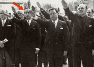 On July 18, 1974, the 38th anniversary of the military coup of dictator Francisco Franco, his close ally, Juan Antonio Samaranch [red arrow] raises his arm in the typical fascist salute.