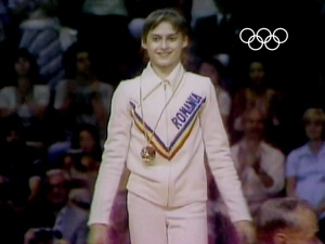 At the 1976 Montreal Olympics, Nadia Comaneci received seven perfect scores and three gold medals –  making history with her score of a perfect 10. She won in the uneven bars, the balance beam and the all-around.