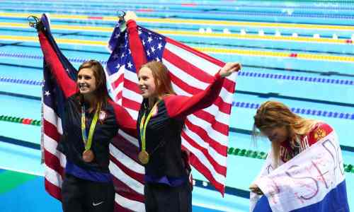 """Medallists Katie Meili and Lily King celebrate alongside Russia's Yulia Efimova after the women's 100m breaststroke final. """"In the Olympic Games, usually all wars stop, but now they can't find a way to beat Russia and now they try to make use of athletes."""" """"I would really like to encourage my fellow athletes to understand my problems,"""" Efimova said, """"and not let politics into it,"""" Efimova said. """"It is very upsetting that some athletes don't believe that. They watch television, they read newspapers, they have no idea of the facts."""" 