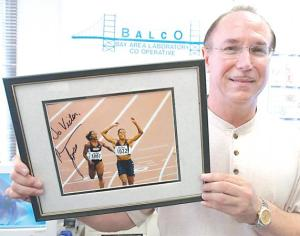 n this file photo, BALCO founder Victor Conte holds up an autographed photo addressed to himself of track star Marion Jones in his office in Burlingame, Ca. Conte pleaded guilty to conspiracy to distribute steroids and money laundering.