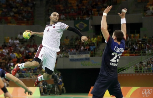 Qatar's Marko Bagaric, left, tries to score past France's Ludovic Fabregas during the men's preliminary handball match between France and Qatar at the 2016 Summer Olympics on Tuesday in Rio de Janeiro | Ben Curtis/AP