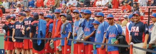 Cuban and US players watch batting practice from the field at Fenway Park