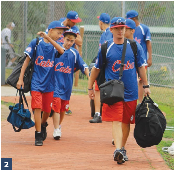 Translator Yosel Vázquez (front) leads the Cuba youth towards the bus after their first U.S. showers