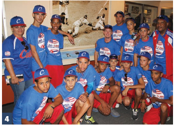 Team Cuba poses in front of a picture of Jackie Robinson at the Baseball Hall of Fame