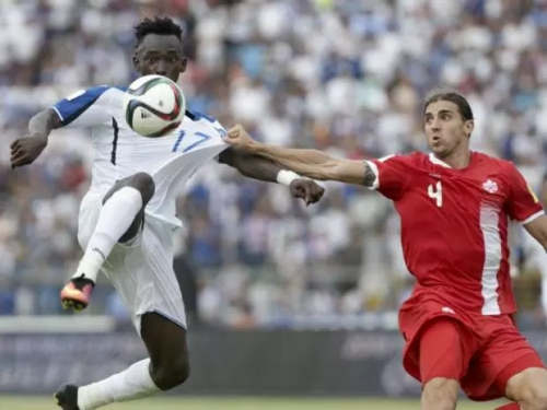 Honduras' Alberth Elis, left, and Canada's Dejan Jakovic battle for the ball during a World Cup qualifying match in San Pedro Sula, Honduras, on Friday. Honduras won 2-1 | Arnulfo Franco/AP Photo