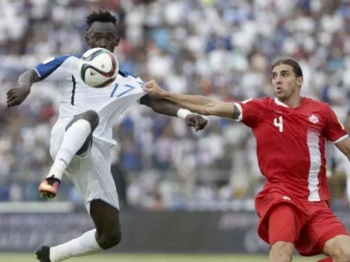 Honduras' Alberth Elis, left, and Canada's Dejan Jakovic battle for the ball during a World Cup qualifying match in San Pedro Sula, Honduras, on Friday. Honduras won 2-1 | Arnulfo Franco/AP Photo