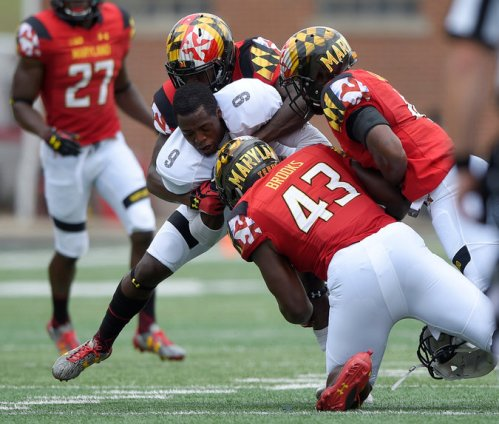 Howard wide receiver Jalen Avery (9) was gang-tackled by the the Maryland defense on Sept. 3. Howard was paid $350,000 to take a 52-13 beating | Nick Wass/Associated Press