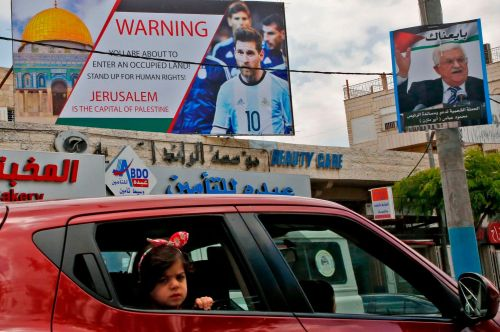 2018.06.05.Poster in the West Bank denouncing the friendly football match between Argentina and Israel.HAZEM BADER:AFP
